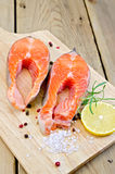 Trout on board with lemon and rosemary Royalty Free Stock Photos