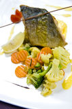 Trout dish. Main course of deliciour trout fish with vegetables Royalty Free Stock Photos