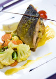 Trout dish. Main course of deliciour trout fish with vegetables Royalty Free Stock Photography