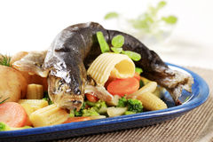 Trout en papillote with mixed vegetables. And potatoes Stock Image