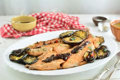 Trout Fillet with Chili Sauce - Entire Recipe Preparation. Grilled Trout Fillet with Chili Sauce and Eggplants - a set of photos showing an entire recipe royalty free stock photos