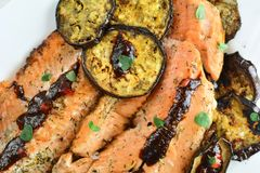 Trout Fillet with Chili Sauce - Entire Recipe Preparation. Grilled Trout Fillet with Chili Sauce and Eggplants - a set of photos showing an entire recipe royalty free stock image