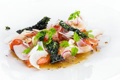 Trout fillet. With dash stock, chervil and radish Stock Photography
