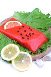Trout fillet with lemon, garlic and lattuces leaves Stock Image