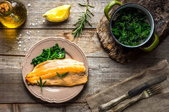Trout fillet with spinach Royalty Free Stock Photography