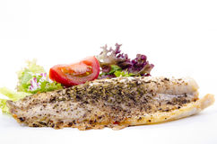 Trout fillet with tomato and salad Stock Image