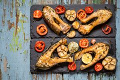 Trout fish with baked vegetables, garlic, thyme, tomatoes Stock Images