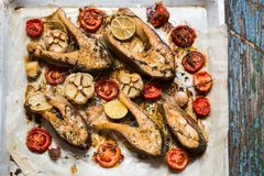 Trout fish with baked vegetables, garlic, thyme, tomatoes Stock Photos