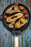 Trout fish with baked vegetables, garlic, thyme, tomatoes Stock Image
