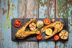 Trout fish with baked vegetables, garlic, thyme, tomatoes Royalty Free Stock Photography