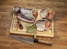Fish on the cutting board royalty free stock images