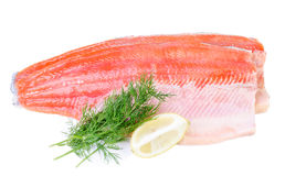 Trout fish fillet isolated on a white background. Commercial composition of trout fish fillet royalty free stock images