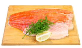 Trout fish fillet on a kitchen board Stock Photography