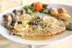 Trout fish with lemon sauce Stock Photography
