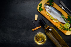Trout Fish with White Wine and Copy Space Area Royalty Free Stock Photo