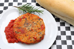 Trout fishburger with tomato sauce Stock Image