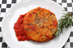 Trout fishburger with tomato sauce Royalty Free Stock Image