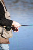 Trout fishing. Man trout fishing easing the fly Royalty Free Stock Image