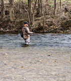 Trout Fishing. Roanoke County, VA – March 18th: Fisherman fishing for trout on the Roanoke River off the Roanoke Valley Greenway on March 18th, 2017, Roanoke Royalty Free Stock Photo