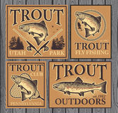 Trout fishing. Vintage trout fishing emblems, labels and design elements Royalty Free Stock Photography