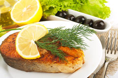 A trout is fried with basil Royalty Free Stock Photo