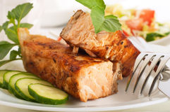 A trout is fried with a pepper and basil Stock Photo