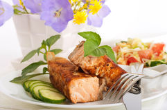 A trout is fried with a pepper and basil Royalty Free Stock Photos