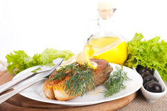 A trout is fried with a pepper and basil, oil Royalty Free Stock Photo