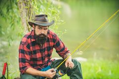 Trout on a hook. Man fly fishing. Brown trout being caught in fishing net. Fly fisherman using fly fishing rod in royalty free stock photography