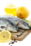 Trout, lemon and olive oil. Royalty Free Stock Images