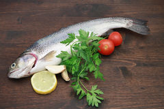 Trout with lemon and tomatoes. A view of trout with lemon and tomatoes royalty free stock image
