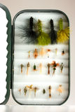 Trout lures in fly box Stock Photo
