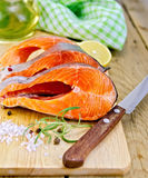 Trout with oil and knife on board Royalty Free Stock Photography