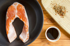 Trout in the pan with the sauce and spices Royalty Free Stock Photography