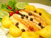 Trout plate with caper, wild shrub. Sauté potatoes Royalty Free Stock Photos
