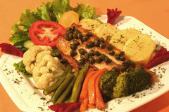 Trout plate with caper, wild shrub Royalty Free Stock Photos