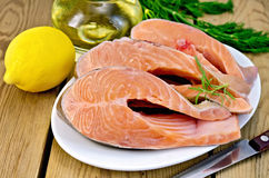 Trout in plate with lemon on board Royalty Free Stock Photos