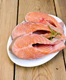 Trout in plate with rosemary on board Royalty Free Stock Image