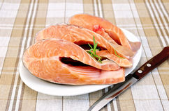 Trout in plate with rosemary on napkin Stock Image