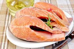 Trout in plate with rosemary and oil on napkin Stock Photo