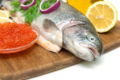 Trout, red caviar in a glass bowl and lemon close up Royalty Free Stock Photos