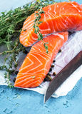 Trout and rosemary on a wooden Royalty Free Stock Photo