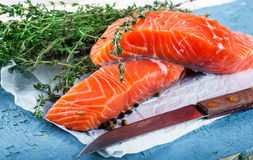 Trout and rosemary on a wooden Royalty Free Stock Photography