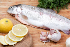 Trout on chopping board Royalty Free Stock Images