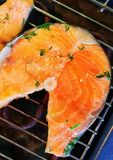 Trout steak fried on grill. Royalty Free Stock Image