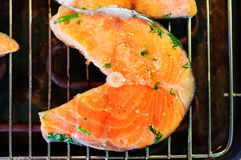 Trout steak fried on grill. Royalty Free Stock Photography