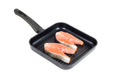Trout steak at grill pan. On a white background Stock Photos
