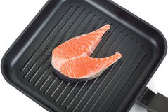 Trout steak at grill pan. On a white background Royalty Free Stock Photo