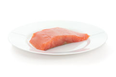 Trout steak on white plate Royalty Free Stock Photo