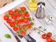 Trout, Tomatoes, and Basil. Stock Images